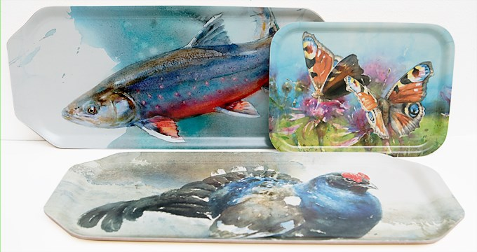 Tree trays of different sizes and with different motives (Black Grouse, Char and European peacock butterfly)  painted by the artist Roland Jonsson (also an honorary doctor at SLU since 2016)..